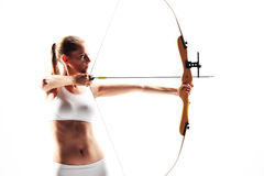 Determined young woman archer stock photo