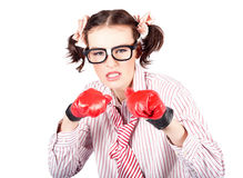 Determined young woman in boxing gloves Stock Photo