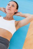 Determined young woman doing abdominal crunches Royalty Free Stock Images