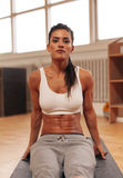 Determined young woman exercising at gym royalty free stock photo