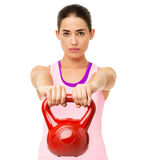Determined Young Woman Lifting Kettle Bell Royalty Free Stock Image