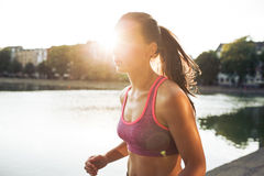 Determined young woman out for a run royalty free stock image