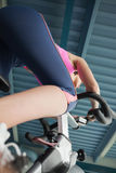 Determined young woman working out at spinning class Royalty Free Stock Photo