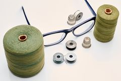 Two reels of thread. Determining the grade of material produced by external inspection of the packaging Royalty Free Stock Image