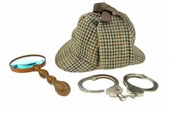 Detetive Hat, Magnifer retro e algemas reais fotografia de stock