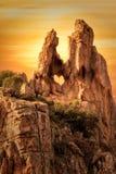 detformade hålet vaggar in i Calanchesen i Korsika på solnedgången Fotografering för Bildbyråer