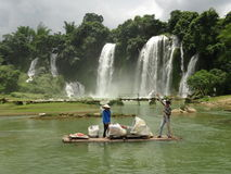 Detian waterfall China. Bamboo boat on the international border between China and Vietnam. Beautiful and large waterfall Stock Photo