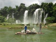 Detian waterfall China. Bamboo boat on the international border between China and Vietnam. Beautiful and large waterfall Stock Photo