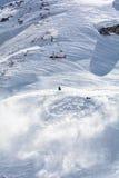 Detonating bell for avalanches prevention. Helicopter with bell detonating anti avalanche Stock Image