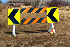Detour construction barricade along a gravel road Royalty Free Stock Image