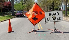DETOUR and ROAD CLOSED Signs. On residential neighborhood street stock photo