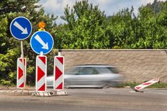 Detour on the road. Traffic signs. Repair of asphalt road. Detour on the road. Traffic signs. Repair of asphalt road Royalty Free Stock Images