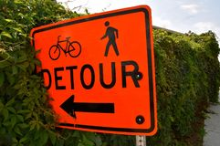 Detour sign leads into the bushes Stock Image