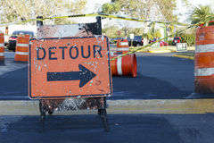 Detour sign in roadway. Orange detour sign around work zone royalty free stock photo