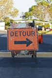 Detour sign in roadway. Orange detour sign around work zone Stock Photography
