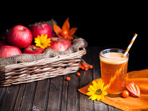 Detox apple juice. Fresh apple juice on wooden background in autumn season Royalty Free Stock Images