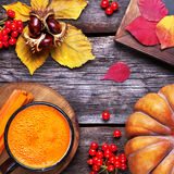 Detox autumn juice. Fresh pumpkin and carrot juice on wooden background in autumn season Royalty Free Stock Image