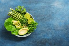 Detox Buddha bowl with avocado, asparagus, micro greens, lime, lettuce, basil and mint.Dietary food. Blue rustic background, top v stock photos