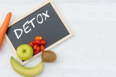 DETOX chalk inscription on the board table. Royalty Free Stock Image