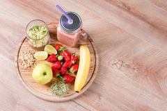 Detox cleanse drink, fruits and berries smoothie ingredients. Natural, organic healthy juice for weight loss diet or. Fasting day. Mason jar of dietary drink royalty free stock photography