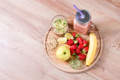 Detox cleanse drink, fruits and berries smoothie ingredients. Natural, organic healthy juice for weight loss diet or. Fasting day. Mason jar of dietary drink stock photography