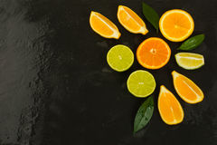 Detox concept with lemon, orange and lime on black background Stock Photography