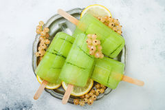Detox cucumber lemon juice popsicles with white currant. Top view, overhead.  Stock Images