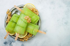 Detox cucumber lemon juice popsicles with white currant. Top view, overhead. Copy space Royalty Free Stock Photo