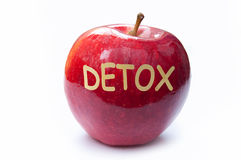 Detox. Cut into a red apple Royalty Free Stock Photo