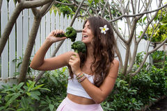 Detox diet. Beautiful young girl with broccoli Stock Images