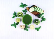 Green smoothie with fruits and vegetables. royalty free stock photography