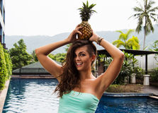 Detox diet. Young beautiful girl with pineapple on her head Stock Photo