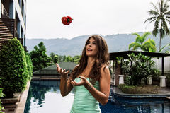 Detox diet: young fit funny girl throwing bell pepper in the sky Royalty Free Stock Image