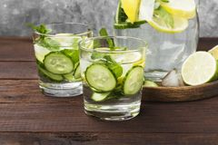 Detox drink with cucumber, lemon and mint in glasses on a wooden. Background Royalty Free Stock Photos