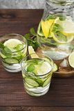 Detox drink with cucumber, lemon and mint in glasses on a wooden. Background Stock Photography