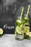 Detox drink with cucumber, lemon and mint on a gray background.  Stock Images