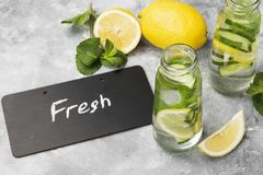 Detox drink with cucumber, lemon and mint on a gray background.  Royalty Free Stock Images