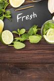 Detox drink with cucumber, lemon and mint on a wooden background. Top view, copy space. Food background Royalty Free Stock Photos