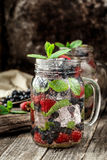Detox drink with fresh berries in glass jars Stock Images