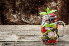 Detox drink with fresh berries in glass jars Stock Photos