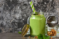 Detox drink - Green smoothie with spinach, mint, yogurt and gran Stock Photos