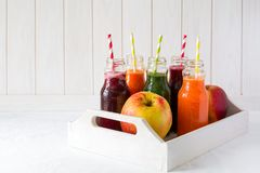 Detox drinks in bottles: fresh smoothies from vegetables: beet, carrot, spinach, cucumber and apple Stock Image