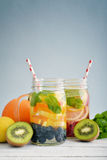 Detox drinks with fresh fruits Royalty Free Stock Photos