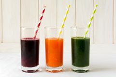 Detox drinks in glasses: fresh smoothies from vegetables: beet, carrot, spinach, cucumber and apple Stock Photography