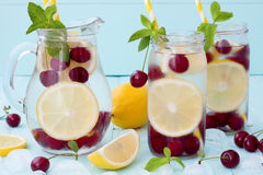 Detox fruit infused flavored water with cherry, lemon and mint Royalty Free Stock Image