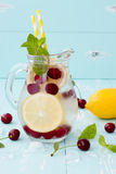 Detox fruit infused flavored water with cherry, lemon and mint Stock Image