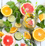 Detox fruit infused flavored water, lemonade, cocktail in a beverage dispenser with fresh fruits Cleanse body and burn fat Royalty Free Stock Images