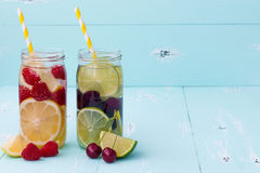 Detox fruit infused flavored water. Refreshing summer homemade cocktail. Clean eating Royalty Free Stock Photos