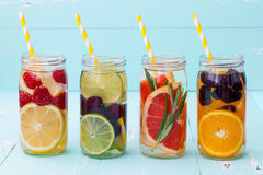 Detox fruit infused flavored water. Refreshing summer homemade cocktail. Clean eating. Detox fruit infused flavored water. Refreshing summer homemade cocktail royalty free stock photo
