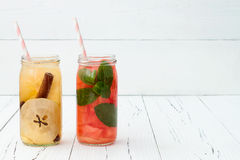 Detox fruit infused flavored water. Refreshing summer homemade cocktail. Clean eating. Copy space background Stock Image